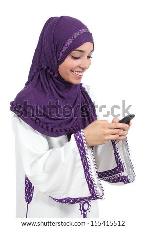 Beautiful arab woman browsing her smart phone isolated on a white background             - stock photo