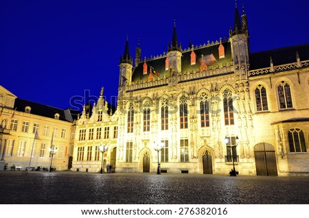 Beautiful architecture of Bruges City Hall and Burg square at night, Belgium