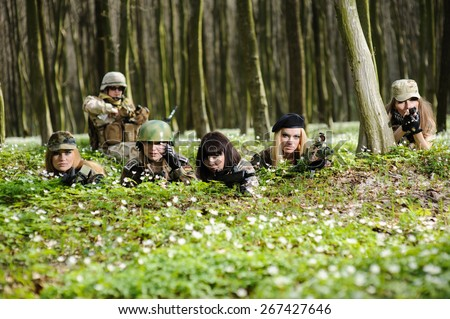Beautiful army girls with gun  outdoor in the forest