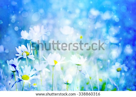 Beautiful artistic background with meadow of daisies in dreamy colors with bokeh lights - stock photo