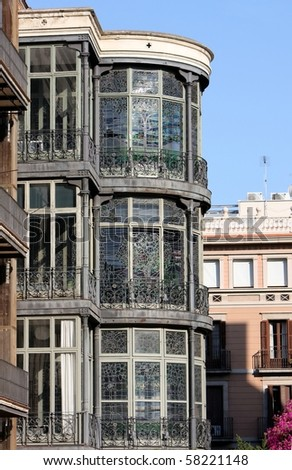 beautiful artistic stainded glass work on architectural house in Barcelona