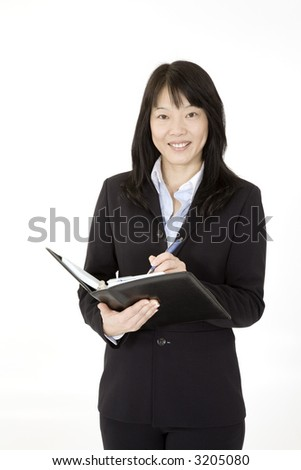 Beautiful Asain Businesswoman working with a day planner on a white background