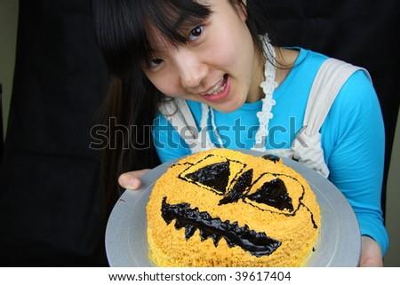 beautiful asia woman hold Halloween hot chocolate cake - stock photo