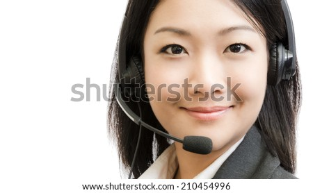Beautiful asia young business woman with headset isolated on white background - stock photo