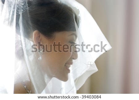 Beautiful Asian bride with smiling. - stock photo