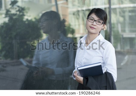 Beautiful Asian business woman in construction site. - stock photo