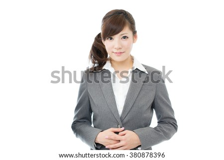 Beautiful asian business woman isolated on white background - stock photo