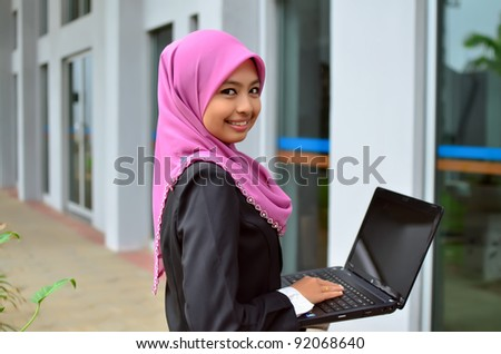 Beautiful asian business woman smile with laptop