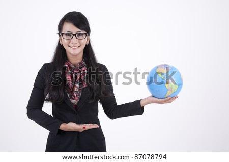 Beautiful Asian Business woman with glasses holding a globe