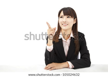 beautiful asian businesswoman pointing something - stock photo