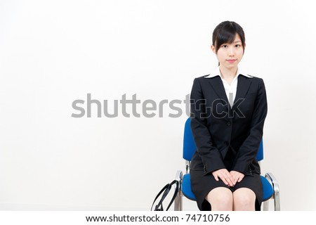 beautiful asian businesswoman sitting on the chair - stock photo