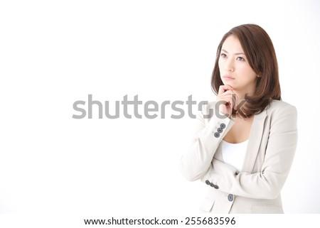 beautiful asian businesswoman thinking on white background - stock photo