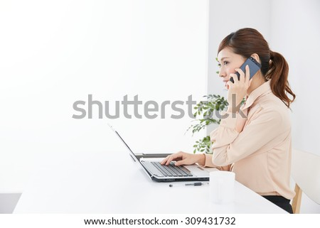 Beautiful asian businesswoman using a laptop computer. - stock photo