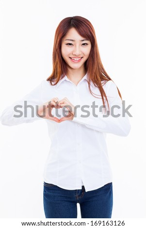 Beautiful Asian casual woman show heart shape isolated on white background.