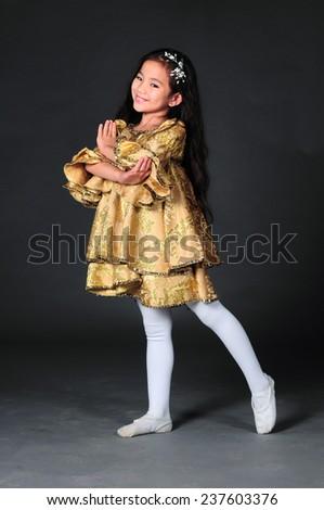 Beautiful asian dancing girl - stock photo