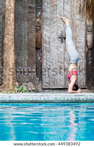 Beautiful Asian Girl   exercise outdoors by the pool - stock photo