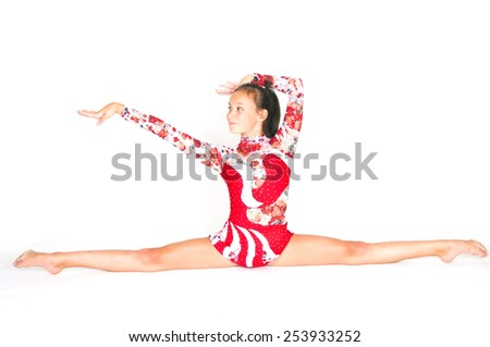 Beautiful Asian girl gymnast on white background - stock photo