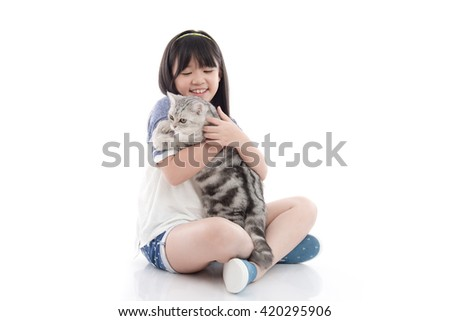 Beautiful Asian girl playing with lovely tabby kitten on white background,isolated - stock photo