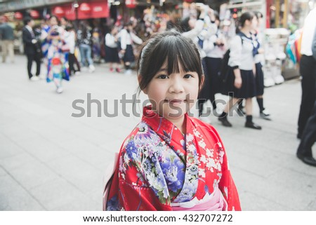 Beautiful Asian girl wearing red kimono  walking in the city,Asakusa Tokyo Japan. - stock photo
