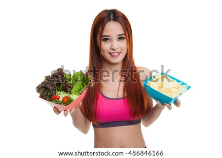 Beautiful Asian healthy girl salad and potato chips  isolated on white background.