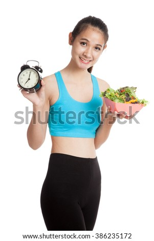 Beautiful Asian healthy girl with clock and salad  isolated on white background