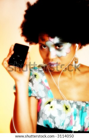 Beautiful Asian Indonesian woman with artistic make-up and digital music player.