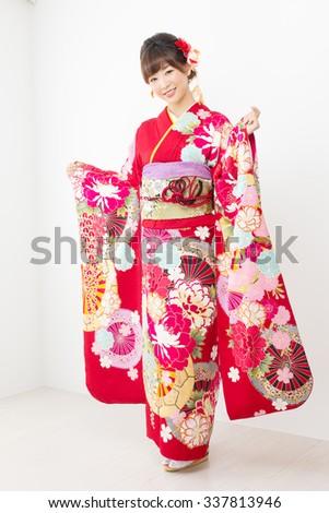 Beautiful asian kimono woman on white background  - stock photo