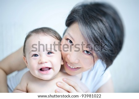 Beautiful Asian Mixed Baby & Mother - stock photo