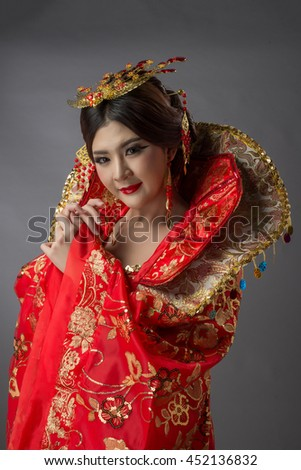 Beautiful Asian model Young asia Oriental woman wearing chinese dress - studio shot