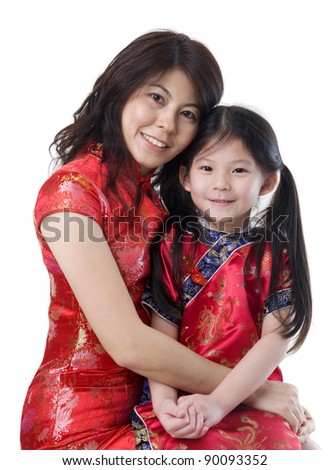 beautiful asian mother and daughter in traditional costume, cheongsam - stock photo