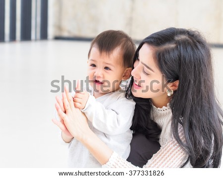 Beautiful Asian mother and son on indoor daylight. - stock photo