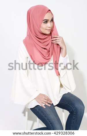 beautiful asian muslimah woman model posing on white wall studio with different expression