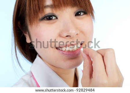 Beautiful asian nurse - stock photo