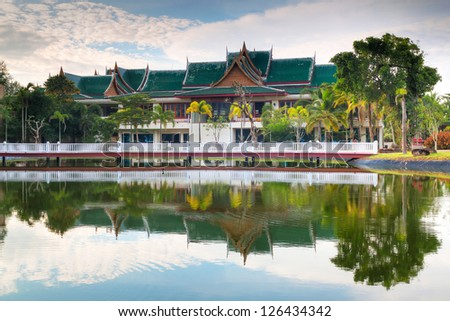 Beautiful Asian resort reflected in pond, Thailand