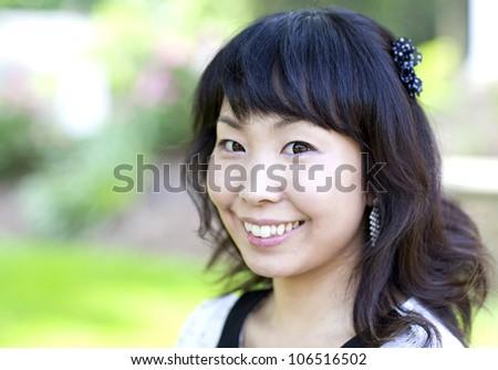 Beautiful asian woman close up portrait - stock photo