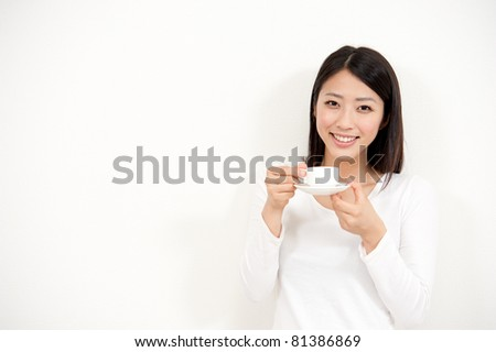 beautiful asian woman drinking a cup of coffee
