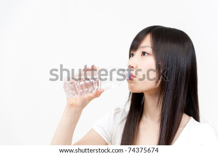 beautiful asian woman drinking pure water