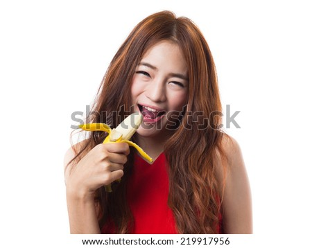 Beautiful asian woman eating banana on white background