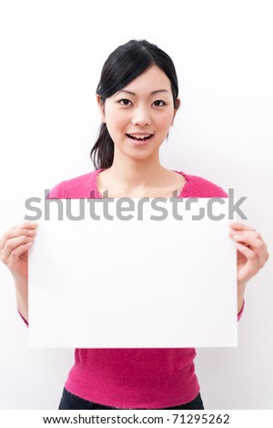 beautiful asian woman holding a blank whiteboard