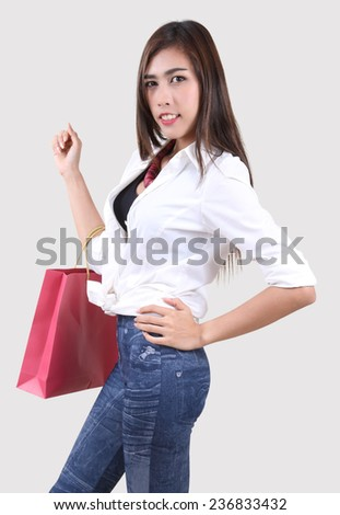 beautiful asian woman holding shopping bag on her hand