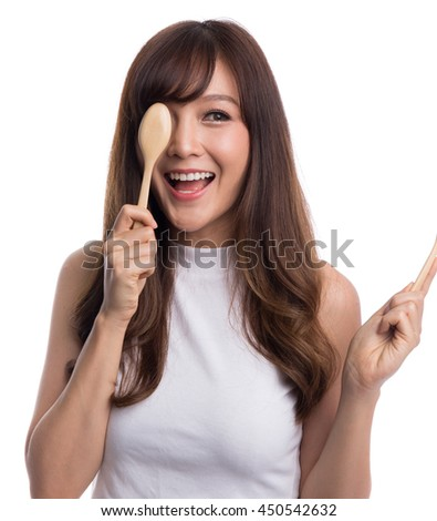 Beautiful asian woman holding spoon and fork covering her eyes, hungry woman or food and lifestyle concepts, isolated on white background