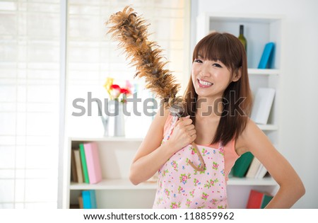 Beautiful Asian woman housekeeping with cleaning house - stock photo
