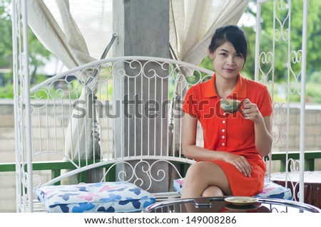 Beautiful Asian woman relax in coffee shop.