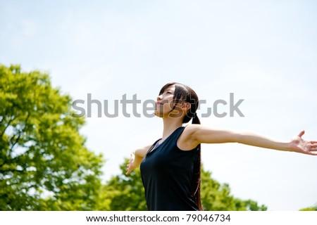 beautiful asian woman relaxing in the park - stock photo