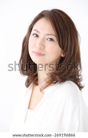 Beautiful asian woman relaxing on white background - stock photo