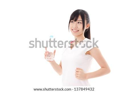 beautiful asian woman running on white background - stock photo