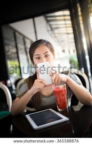 Beautiful Asian Woman Surprising With Mobile Phone : Selective Focus - stock photo