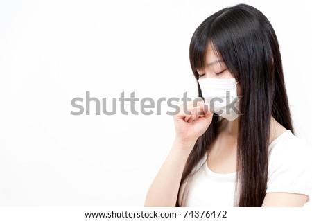 beautiful asian woman taking a mask - stock photo