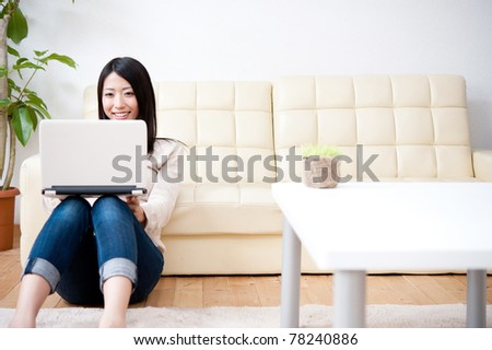 beautiful asian woman using laptop computer - stock photo