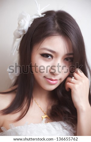 Beautiful asian woman, wearing a wedding dress